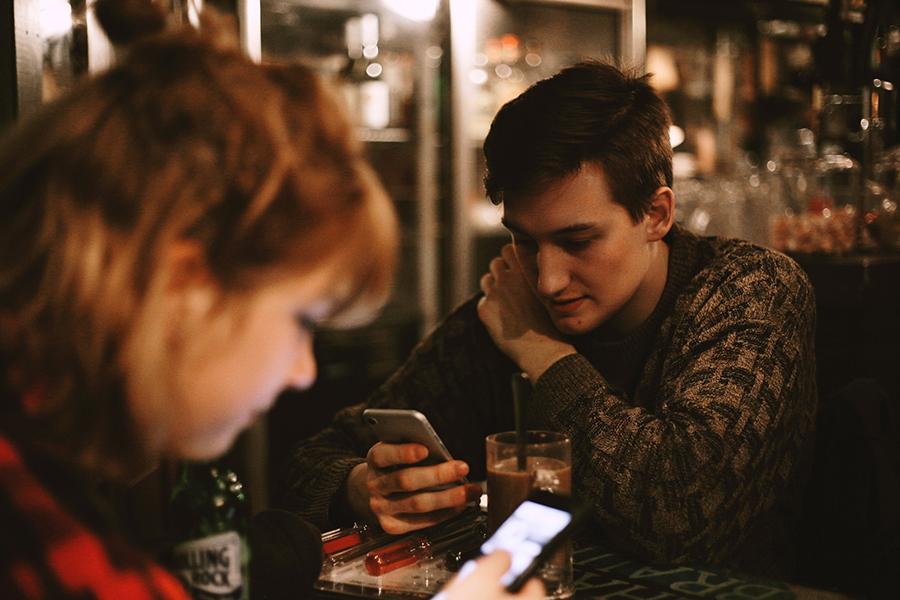 man reading his phone