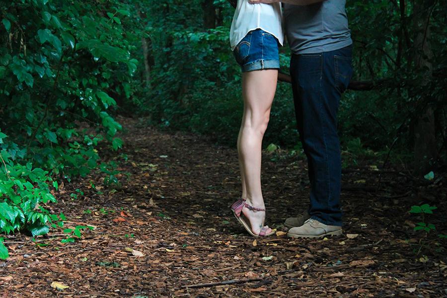 Woman on tiptoes facing a man