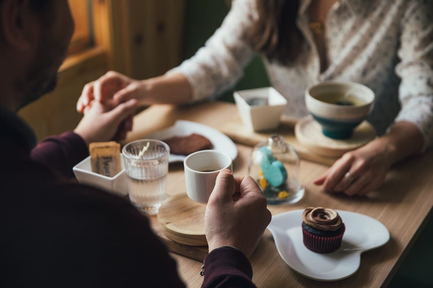couple at a table having coffee