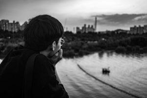 Man Overlooking Water and Thinking - Analysis Paralysis