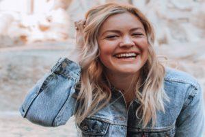 Woman Laughing and Smiling - Flirting Body Language