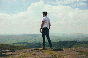 Man Standing on Mountain - Alpha Male Characteristics