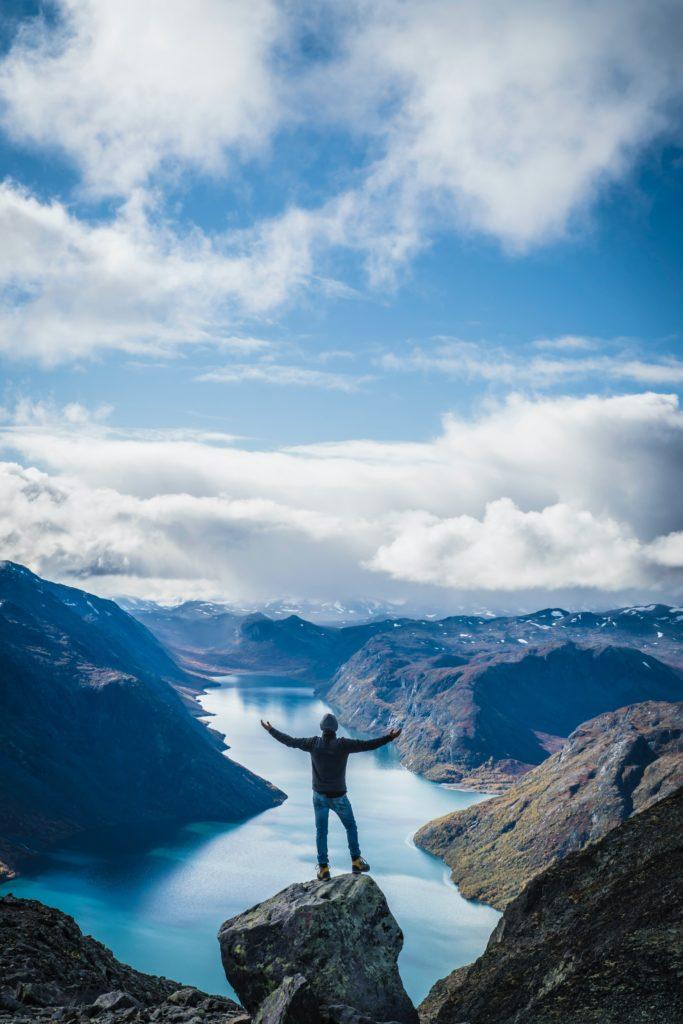 Man Standing on Mountain - Level Up Coaching