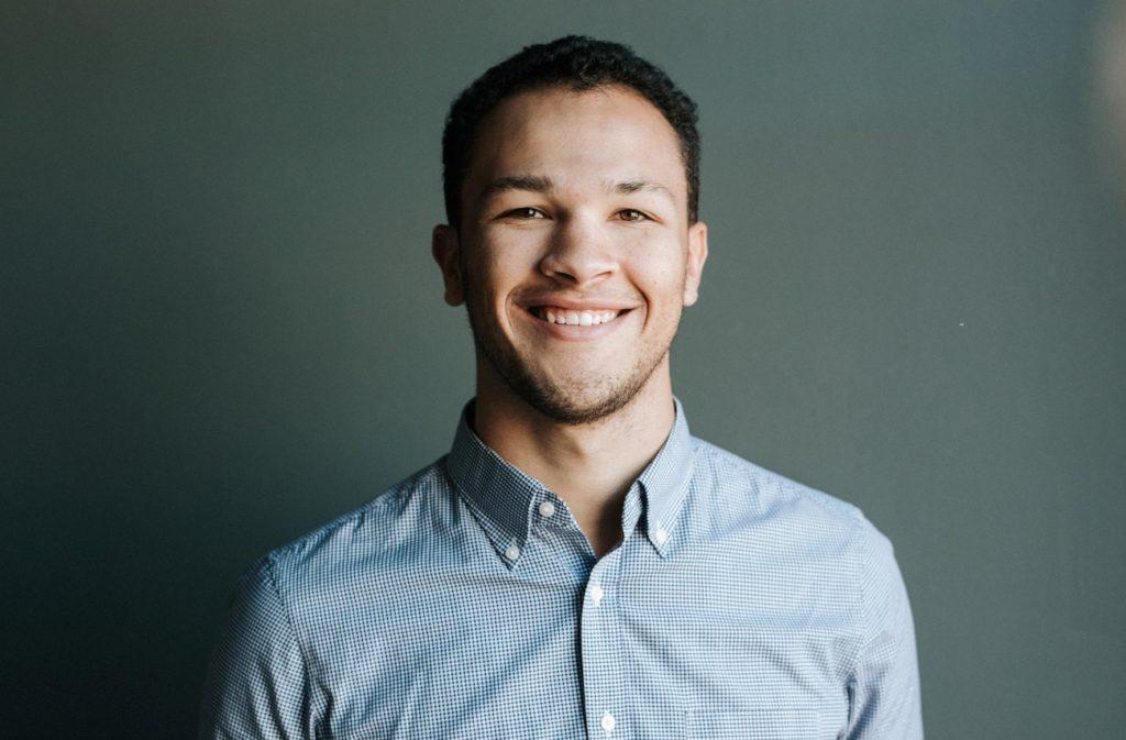 man smiling - alpha male definition